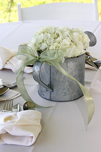 center pieces Galvanized sprinkling cans with wildflowers could be set anywhere. Could even get large galvanized buckets or troughs to stuff with prairie grass. Wad days think, huh? Are we getting there?