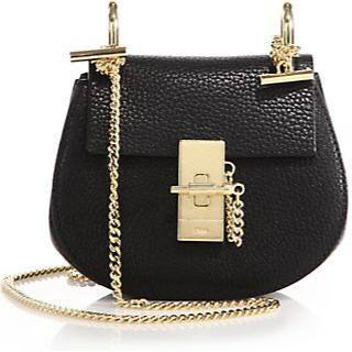 Emma Stone wearing Chloe Black Drew Nano Bag