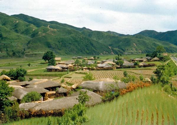 Most Koreans were peasant farmers who lived in villages such as this, and went out every day to work the fields nearby. The villages were built wholly of local materials and seemed to grow naturally out of the earth. In a country of astonishing natural beauty, they were often the most lovely sights of all. Villages were usually only a mile or so apart. It was a rare person who was not moved by their homely beauty and by the surpassing serenity of the Korean landscape.