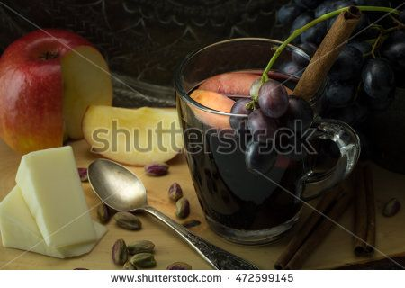 Seasoned glass of red wine, with grapes, apple, pieces of vegan cheese…