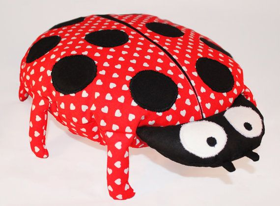 This adorable ladybird cushion is a great snuggle toy. It's ideal as baby shower gift.  Ladybird will add fun and character to child's bedroom or nursery.   It can be used as a toy, decorative cushion or pillow to sleep for a child. The back side is completely smooth and comfortable for head.  Children love these pillows and spend with them all day and night.  It's very delicate and soft. Made of 100% hypoallergenic materials.  You can wash it in the washing machine if it gets dirty.