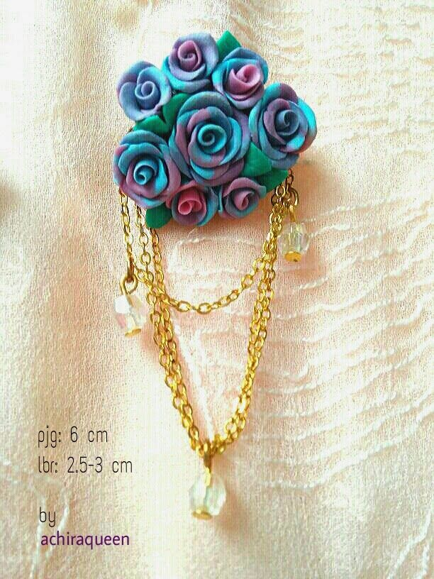 Rose clay brooch. This is handmade with airdry clay