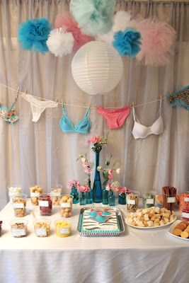 bras and panties on a clothesline, fondue dipper options, and tissue paper balls and lanterns