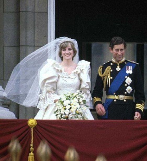 Prince Charles And Princess Diana On The Balcony Of Buckingham Palace On Their Wedding Day in July 1981. The Princess Is Wearing A Wedding Dress Designed By David And Elizabeth Emanuel. The Prince Is Wearing Naval Dress Uniform.