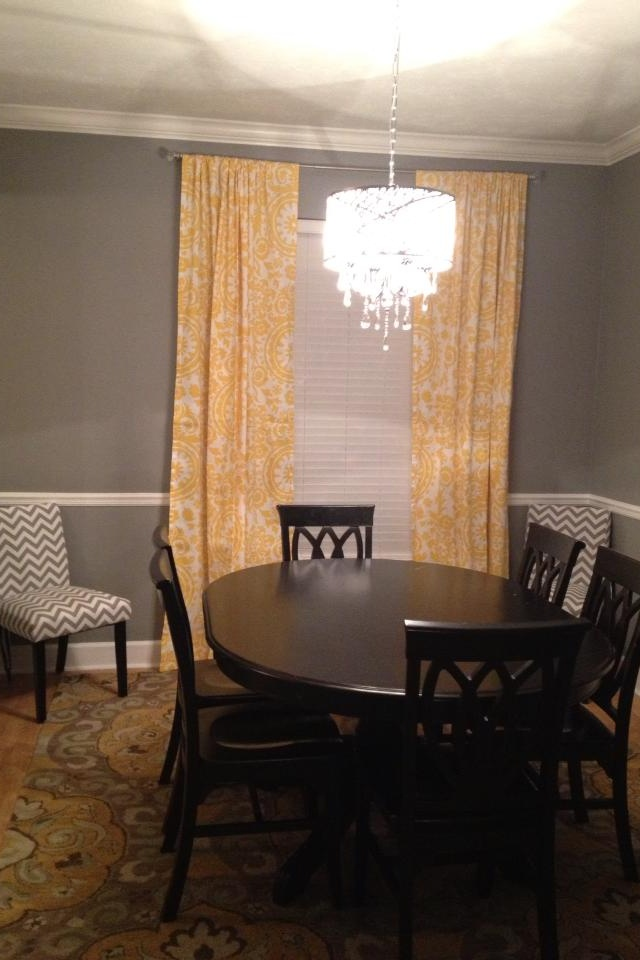 Yellow and grey dining room. Custom curtains.