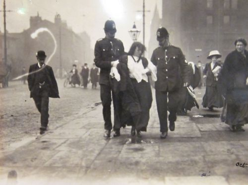 Police constables arrest a Suffragette protestor, London