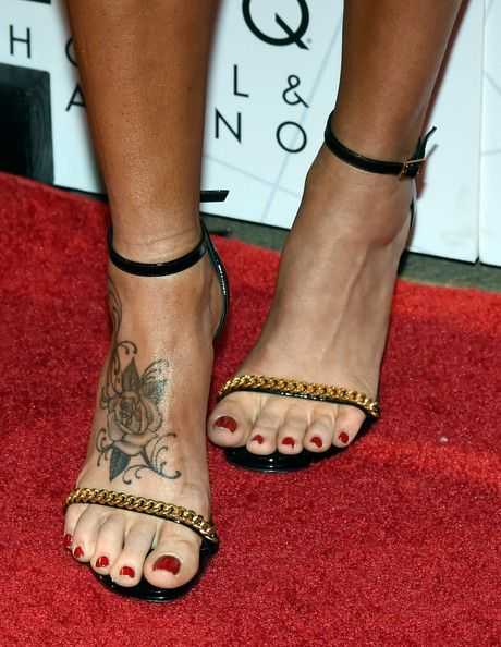 """Jenny McCarthy Photos - Actress/comedian Jenny McCarthy (shoes, tattoo details) arrives at The LINQ to promote her """"Dirty Sexy Funny"""" comedy show on September 25, 2014 in Las Vegas, Nevada. The tour will kick off on September 26 at The Quad Resort & Casino in Las Vegas. - Jenny McCarthy's Comedy Show"""