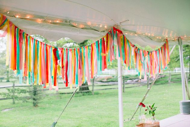 colourful fabric fringe wedding decor | photo by @Lauren Fair