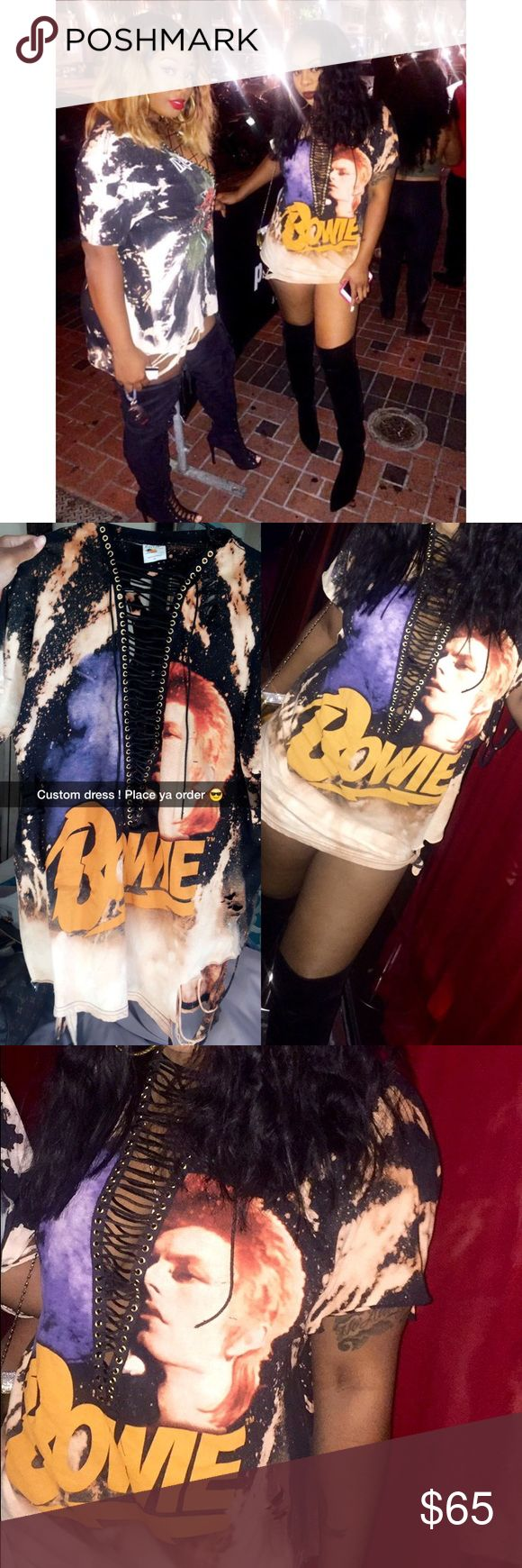 David Bowie distressed T shirt dress David Bowie Graphic Distressed unisex T shirt / OVER SIZED can be worn as a shirt or a dress . I'm 5'7 . Worn once I just had this shirt custom made for a event ! Bleach splattered / rips / holes . With lace up / Can be tied up if you like . Very trendy at the moment ! Feel free to make an offer ;) Dresses Mini
