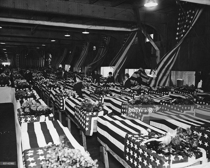 The flag-draped coffins of 111 American servicemen killed in Russia, arrive on board ship at Hoboken, New Jersey, circa 1920. After the October Revolution in Russia, the US sent troops of the American Expeditionary Force Siberia and American Expeditionary Force North Russia (aka the Polar Bear Expedition) to Russia to take part in Allied intervention in the Russian Civil War against the Red Army.