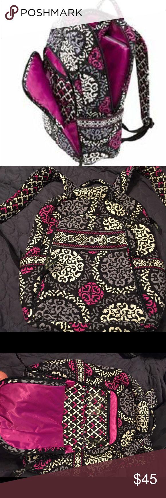 Vera Bradley Laptop backpack Canterbury Magenta Gently used laptop backpack by Vera Bradley, front pocket for holding cards, IDs, keys, and pens. 2 side pockets, adjustable straps. Vera Bradley Bags Laptop Bags