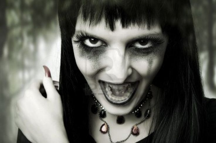 Halloween horror concept. Fashion portrait of witch or night vampire woman. Dark gothic makeup Stock Photo - 10623754
