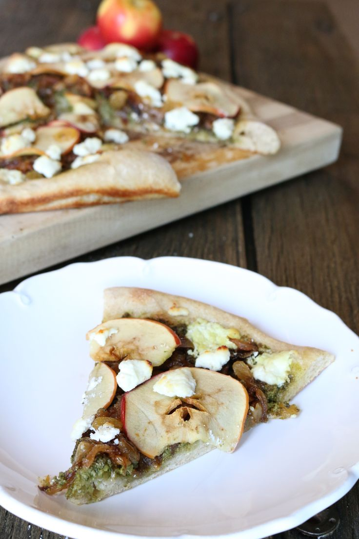... Pizza with Walnut Parmesan Pesto, Caramelized Onions, and Goat Cheese