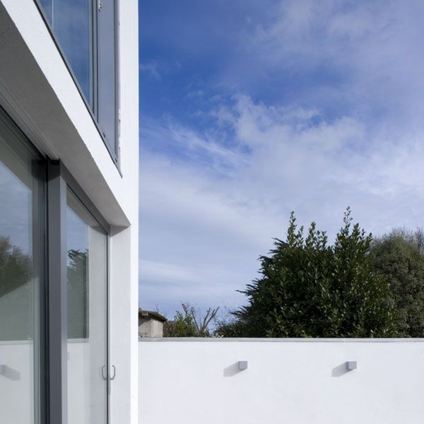 Full height glazing and one sliding door provide views and access via the lower courtyard to the south easterly garden.