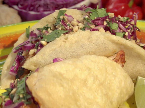 Yucatan Chicken Puffy Tacos with Peanut-Red Chili BBQ Sauce and Red Cabbage Slaw from Bobby Flay care of FoodNetwork.com. not an everyday meal but in case we get ambitious one day