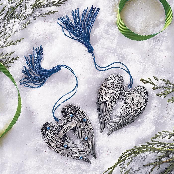 youravon.com/tdenton AVON EXCLUSIVE; Continue the annual tradition of collecting Avons pewter ornaments with this years new addition. Blue faux stones. Comes in a navy velvet-like pouch!FEATURES• Purple string to hang with tassle at end• Pewter ornament with black engraved lines for the feathers• 6 blue stones (3 on each wing)• 2016 on center front on a banner• Back of ange wing is also designed but no stones or 2016, instead it has the A...