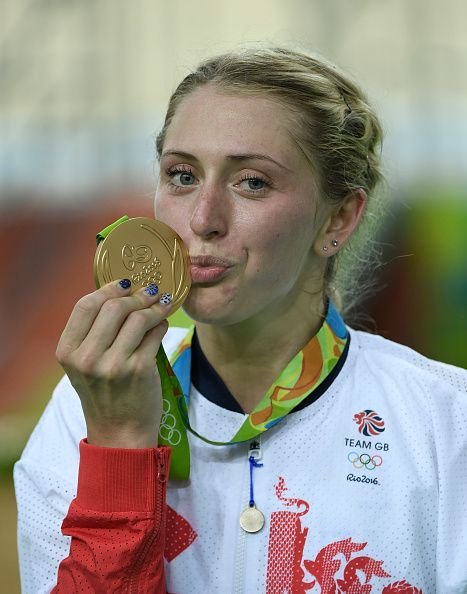Laura Trott of Great Britain celebrates with her gold medal after the women's…