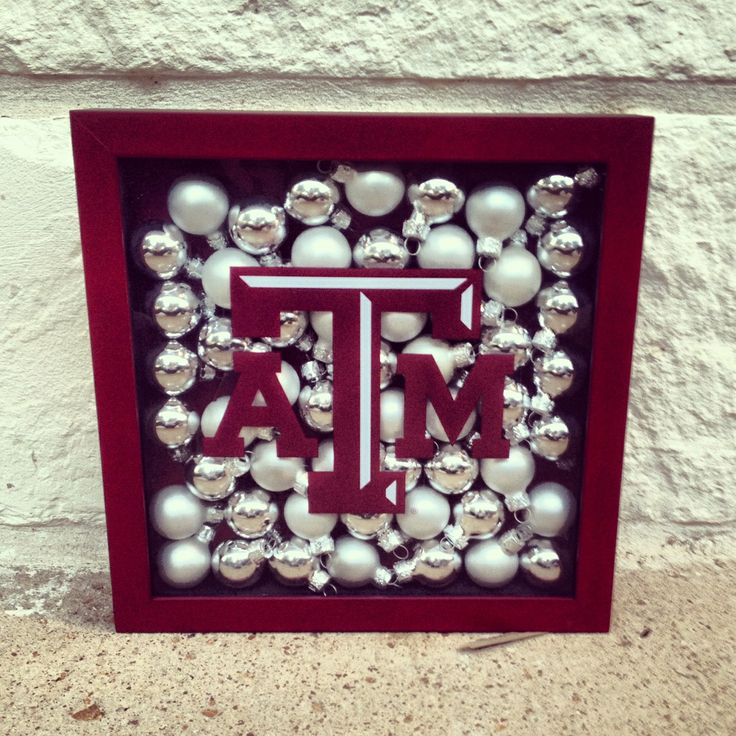 Quick Aggie holiday decor: shadow box, ornaments, maroon spray paint, and a Texas A&M logo decal!