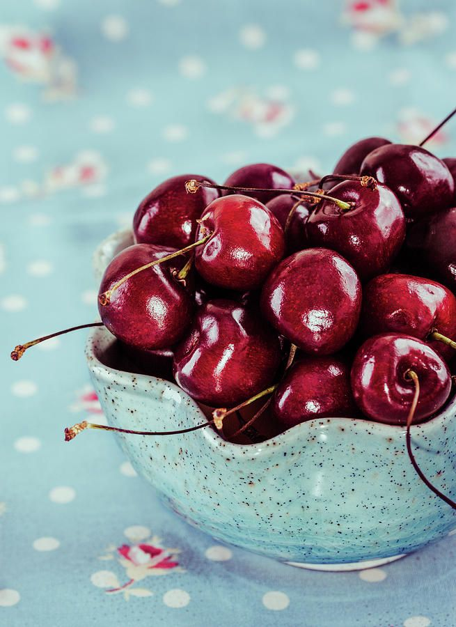 Red Cherries In Blue Ceramic Bowl Photograph by Oksana Ariskina  Red cherries in aqua ceramic bowl and fabrics. Available as mugs, posters, greeting cards, phone cases, throw pillows, framed fine art prints, metal, acrylic or canvas prints, shower curtains, duvet covers with my fine art photography online: www.oksana-ariskina.pixels.com #OksanaAriskina