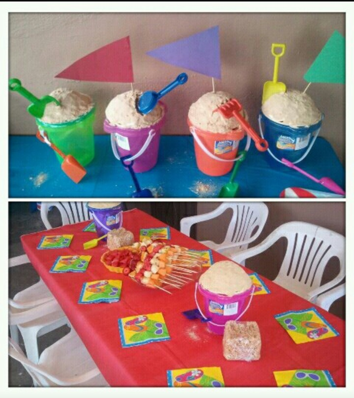Beach summer party with sand bucket cakes (w/graham crackers),fruit on a stick and rice crispy castles! ;)