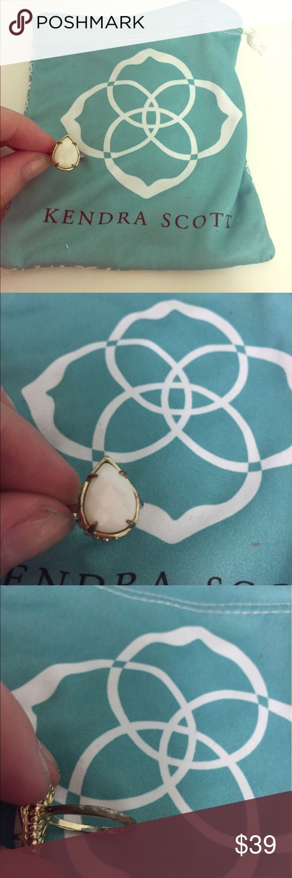 Kendra Scott Daisy white gold ring 7 teardrop Excellent used condition Kendra Scott daisy ring, gold plated with white stone. Gold has rubbed off on the base of the ring, as shown. Re-posting since the seller said it was an 8, but my ring sizer shows a perfect size 7. Beautiful ring, just too small for me! Kendra Scott Jewelry Rings