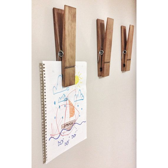What a unique and fun way to display photos, kids drawings or notes in your home, nursery or office with a large rustic decorative walnut stained clothespin. Customize your clothespin with your name or childs name.  This listing is for ONE jumbo sized clothespin - is hand stained in a dark walnut and varnished.  This large 9 clothespin can be hung on the wall or even set upright on a shelf, mantel or on your desk to hold your favorite photo.  This clothespin measures 9 long by 1 3/4 wide and…