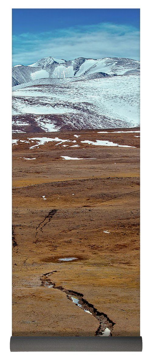 Oksana Ariskina Yoga Mat featuring the photograph Snowy Mountains. Crack From An Earthquake. Russia, Siberia, Altai Mountains by Oksana Ariskina. Russia, Altai, Kosh-Agach on @pixels and @fineartamerica  Buy print and other product with my fine art photography online: www.oksana-ariskina.pixels.com    #OksanaAriskina  #FineArtPhotography #HomeDecor #FineArtPrint #PrintsForSale #Altai #Altay #Nature #Mountains #Ice #Spring #River