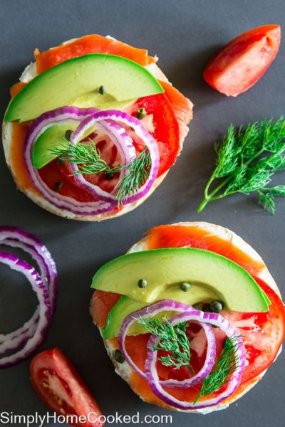 Start your day with this colorful and nutritious breakfast. Wild Alaskan sockeye salmon spread onto warm toasted bagels with cream cheese, avocado, red onion, tomatoes, and fresh dill. These bagels can be customized according to your liking. The important part of the recipe is the bagels, cream cheese, and salmon. From there on