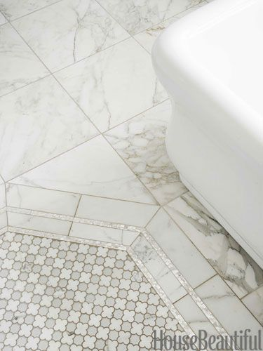 Mother-of-pearl liner tile frames the Arpell Bianco tile and catches the light. All by Artistic Tile.