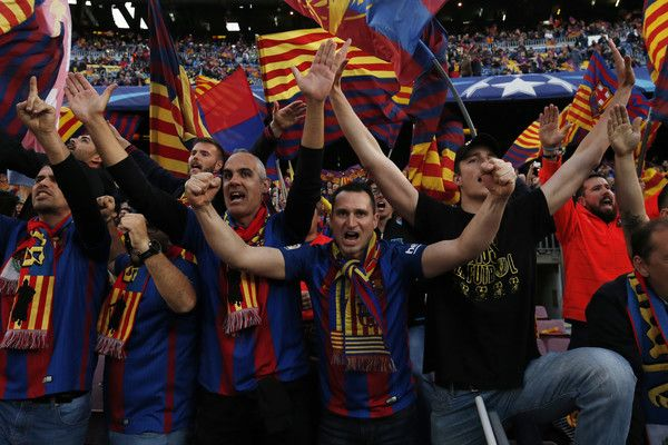 FC Barcelona's supporters cheer their team before the UEFA Champions League quarter-final second leg football match FC Barcelona vs Juventus at the Camp Nou stadium in Barcelona on April 19, 2017. / AFP PHOTO / PAU BARRENA