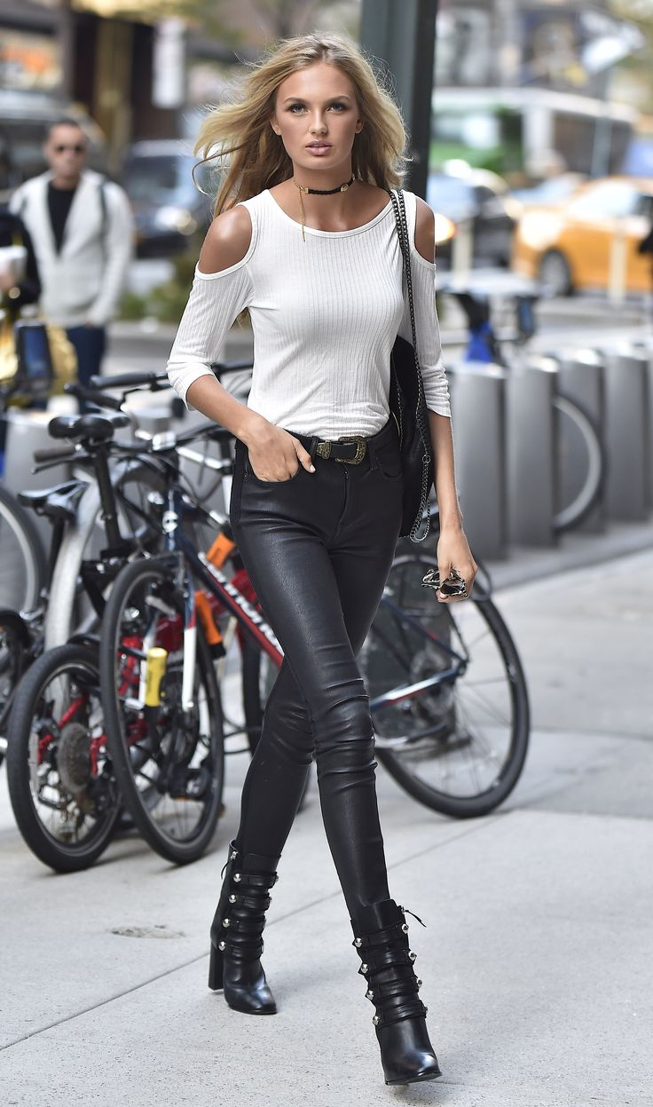 Romee Strijd stepped out in simple but sexy skintight leather pants and a white cold-shoulder top. Her acce...