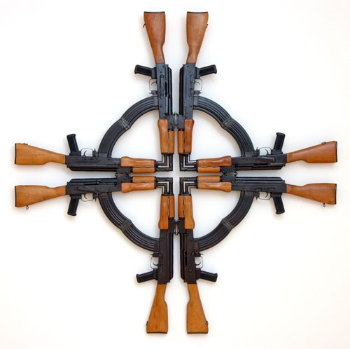 Mel Chin - Cross for the Unforgiven    A Maltese cross of the Crusades, made from eight AK-47s, the international symbol of resistance to the West.