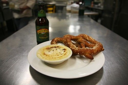 this is a favorite app of ours at the taproom- torpedo beer cheese dip served with soft, pillowy, hot pretzels.
