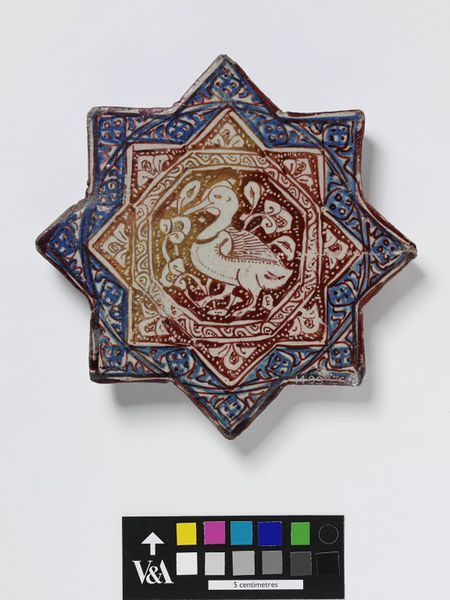 Tile      Place of origin:      Kashan, Iran (probably, made)     Date:      early 14th century (made)     Artist/Maker:      unknown (production)     Materials and Techniques:      Fritware, glazed and painted in cobalt blue and lustre     Museum number:      1493B-1876