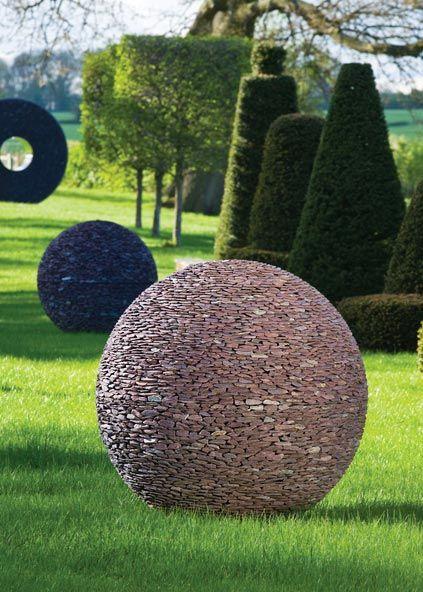 Slate spheres with slate Torus sculpture following a garden path