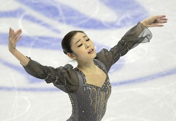 Kim reigns at worlds  Wagner and Gold finish 5th and 6th to gain U.S. 3rd figure skating spot for 2014 Olympics