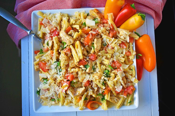 Cajun Louisiana Chicken Pasta is made with sauteed onions, peppers, chicken, in a cajun cream cheese all tossed with pasta and parmesan cheese.