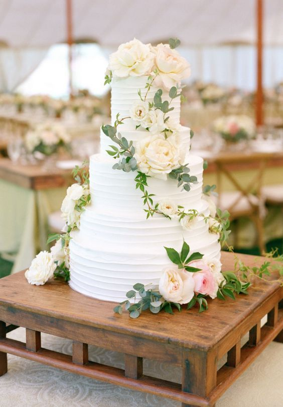Featured Photographer: Aaron Delesie; Elegant five tier white ridge textured wedding cake topped with pretty flowers
