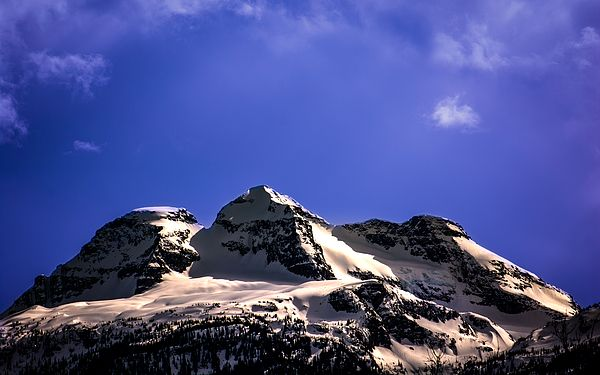 The triple-crowned peak of Revelstoke BC's Mount Begbie on a warm spring afternoon
