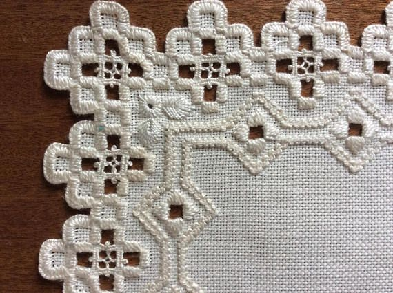Lovely Centrepiece doily worked in Hardanger. Off white. Approx 9 inches Square Will be posted in an envelope off lacerate, so postage is relatively inexpensive.
