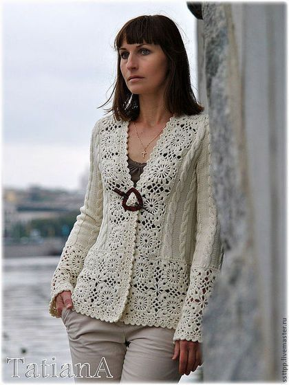 Inspiration only. Body and sleeves are knit, with wide motif border