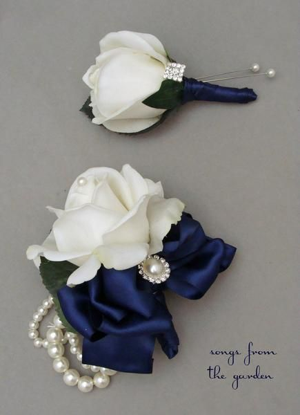 For the mother and father of the bride or groom, this real touch rose boutonniere and corsage set is accented with rhinestone and pearl accents with navy ribbon and can be customized for your color sc