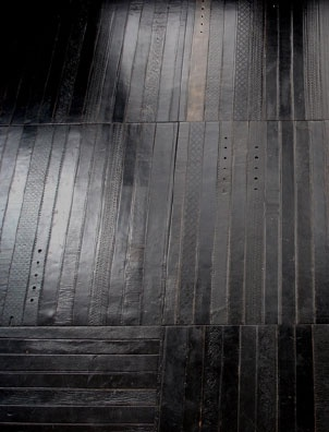 = flooring made from old leather belts