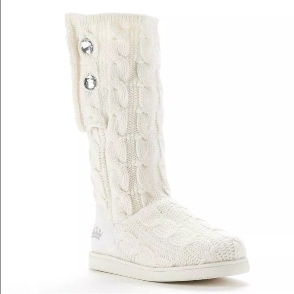 New in the box Juicy Couture Marlen Sweater Boots New in the box Juicy Couture Marlin Women's Sweater Boots: White Rhinestone accents add a hint of shine to these women s Juicy Couture sweater boots.  Cable-knit upper Fabric upper Fleece lining TPR outsole SHOE DETAILS Round toe Pull-on Padded footbed 13-in. shaft 11-in. circumference Rhinestone accents add a hint of shine to these women's Juicy Couture sweater boots.  SHOE FEATURES Cable-knit upper SHOE CONSTRUCTION  Fabric upper  Fleece…