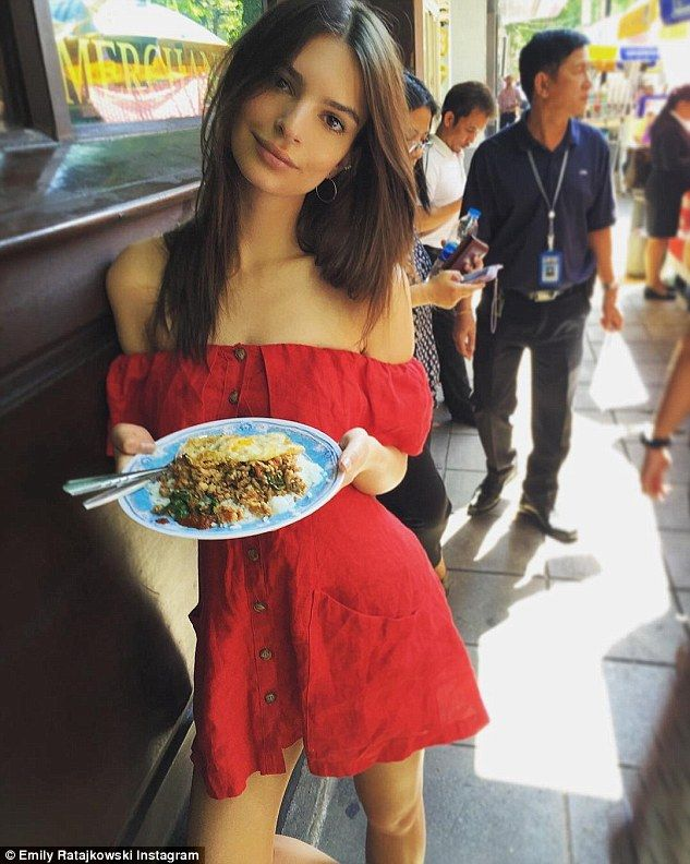 Gastro treat: On Wednesday, the Blurred Lines music video star popped out in an off-the-shoulder very short red dress to try some of Bangkok's tasty street food