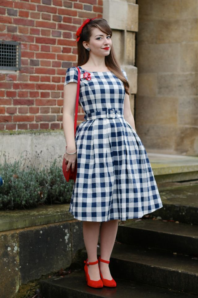 The Dolly & Dotty Vanessa dress in a large blue gingham, with red accessories