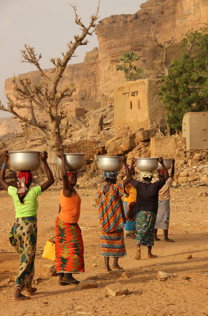 Women carrying water on their heads to a Dogon village, Koro Cercle, Mopti, Mali