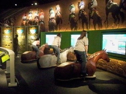 Virtual horse racing experience at the Kentucky Derby Museum.