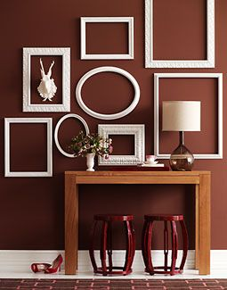 I love the contrast between the walls and the frames. Also, the frames being different sizes creates visual interest without overdoing it with a lot of color.