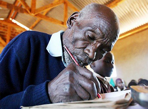 In 2004, 84-year-old Kenyan KIMANI NGA MARUGE-a Mau Mau fighter!!- became the oldest primary school pupil in the world. He said that the government's announcement of universal and free elementary education in 2003 prompted him to enroll. A year later, he was elected head boy of his school.In September 2005, Maruge boarded a plane for the first time in his life, and headed to New York City to address the UN Millennium Development Summit on the importance of free primary education.